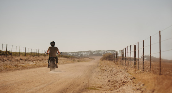 Man riding motor cycle on a country road