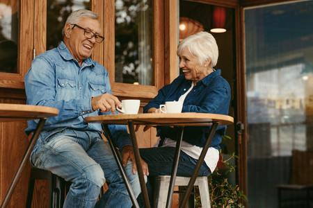 Senior couple having conversation at cafe