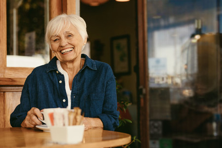 Beautiful senior woman at coffee shop