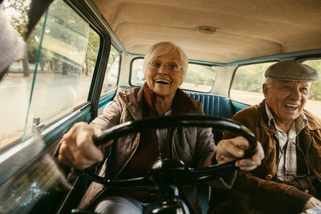 Senior couple having a great time on their drive