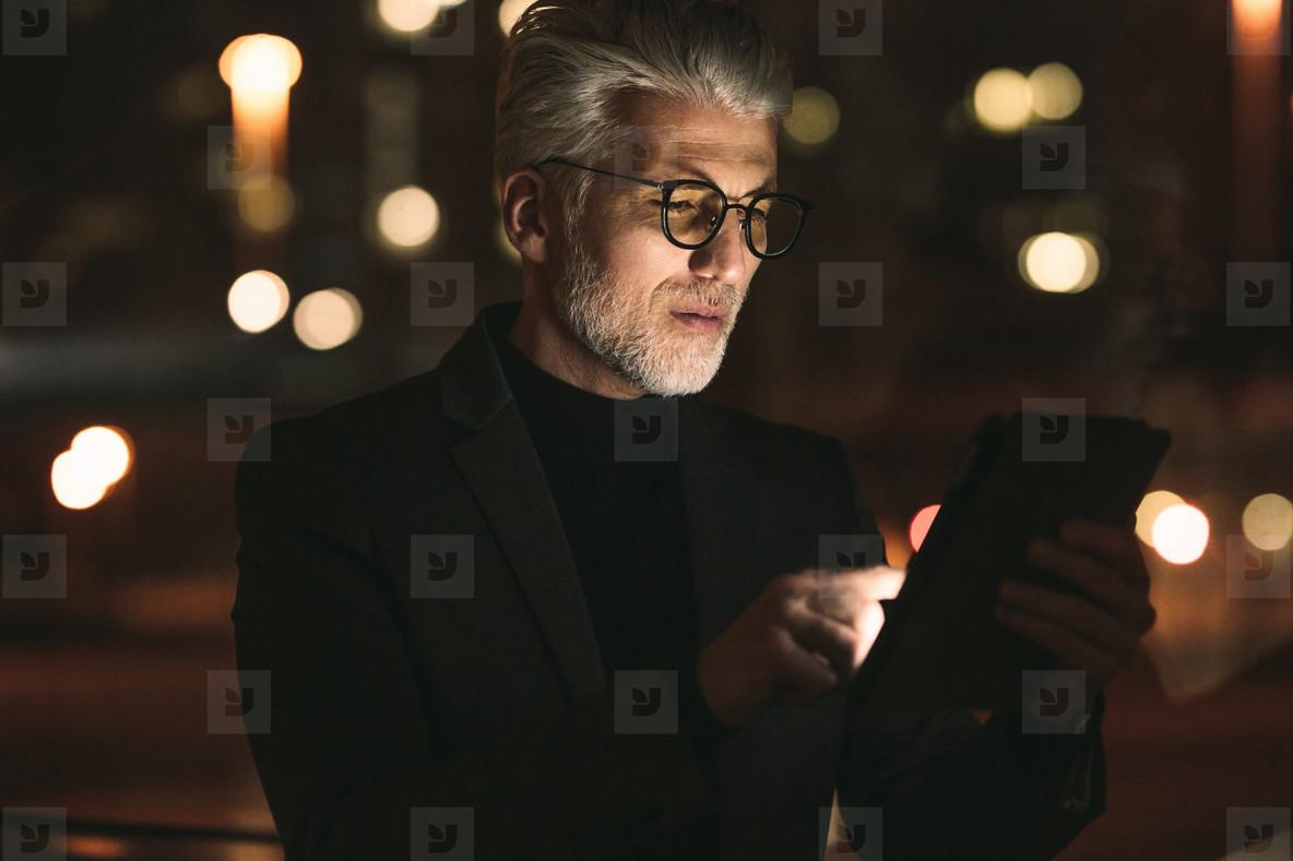 Senior business associate working on tablet computer