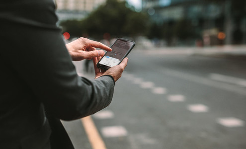 Man ordering taxi pickup with phone app
