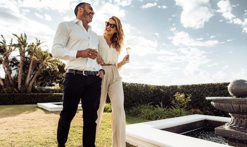Stylish couple walking outdoors and smiling