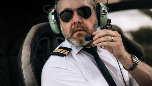 Mature helicopter pilot with headset