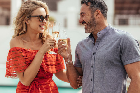 Beautiful portrait of couple toasting wine