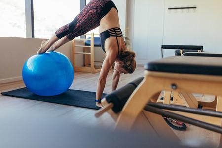Woman doing pilates workout at a gym