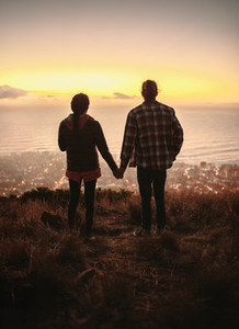 Couple in love watching sunset