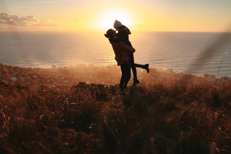 Romantic couple enjoying themselves on peak