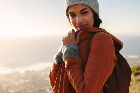 Woman in winter day hiking trip