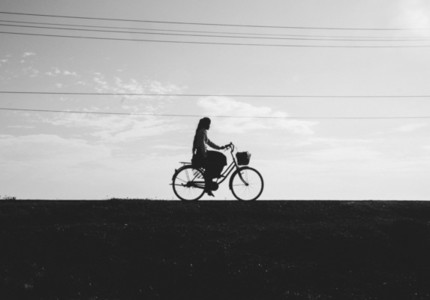 Girl Driving A Bicycle