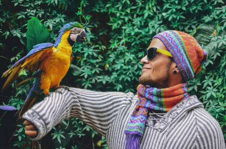 Holding A Colorful Parrot