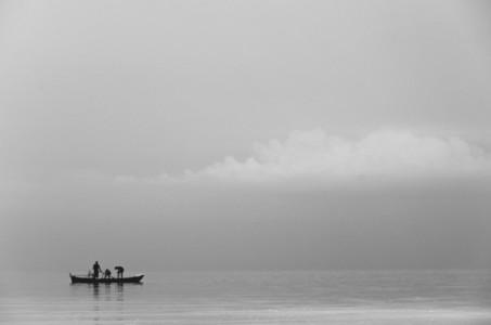 Fishermen casting net