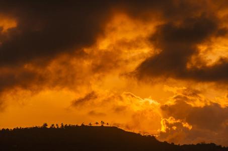 Hill under golden sunset