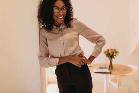 Businesswoman standing at home and posing  for photograph