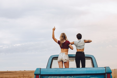 Women enjoying themselves on road trip
