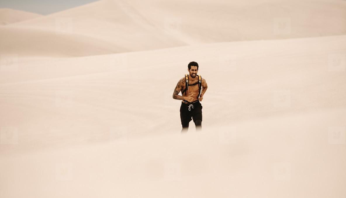 Man doing running exercising in desert