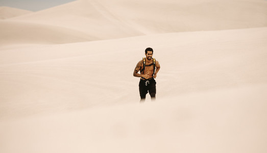Man doing running exercising in desert
