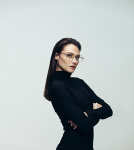 Attractive woman in glasses wearing black dress