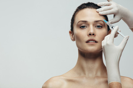 Anti aging serum shot on forehead