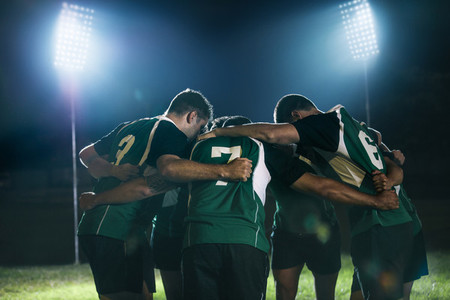 Rugby team in huddle after match
