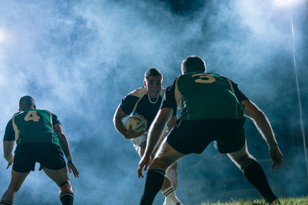 Rugby action under lights