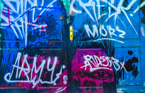 Graffiti on blue doors