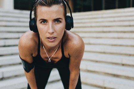 Close up of a woman athlete training wearing headphones