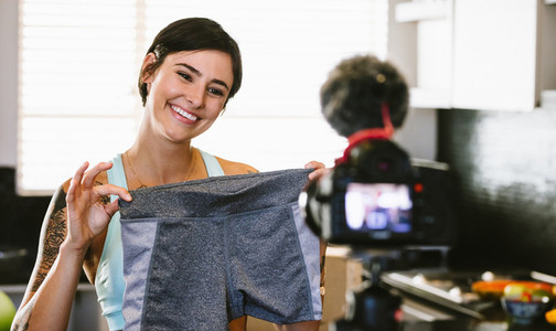 Woman making video blog on new sportswear shorts
