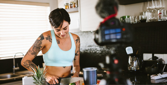 Woman creating a vlog about healthy eating