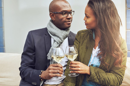 Loving couple toasting with white wine