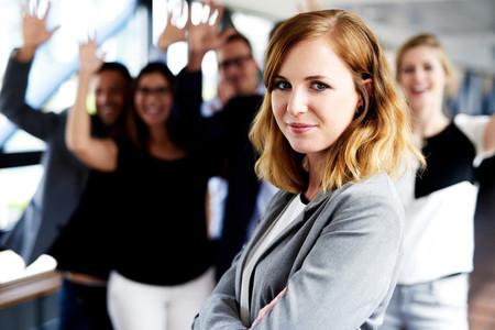 Female executive standing in front of colleagues