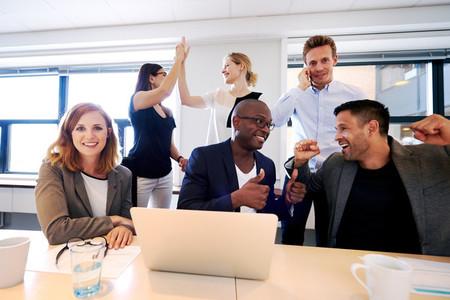 Group of executives celebrating