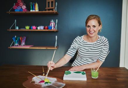 Creative woman painting