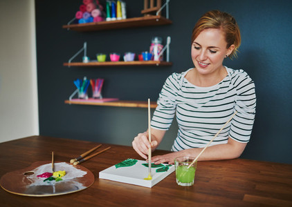Creative female painting at desk