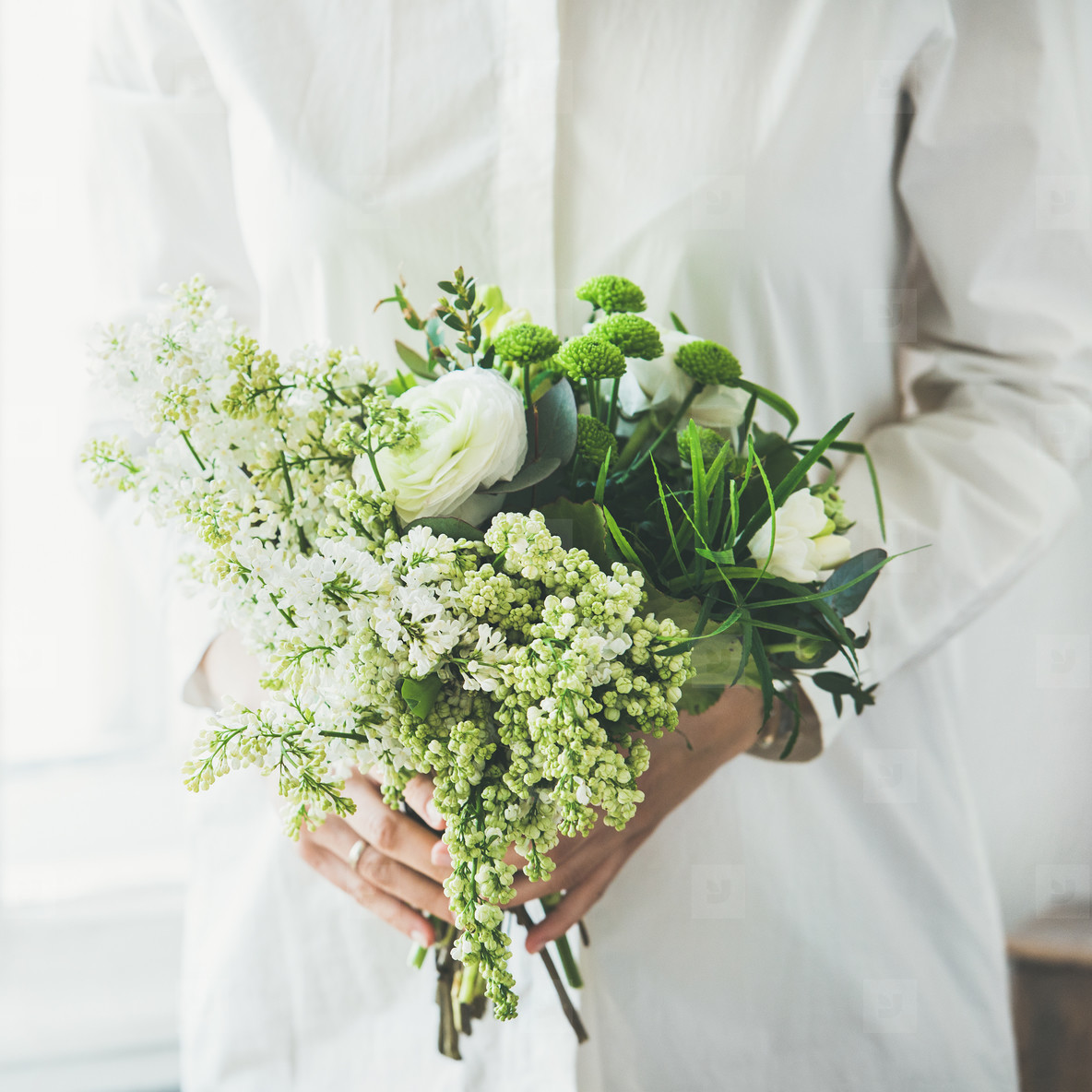 Young woman wearing white clothes holding flowers bouquet  square crop
