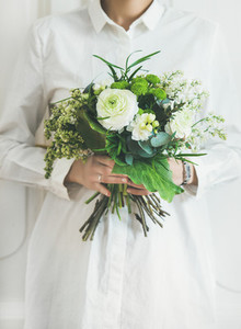 Young woman wearing white clothes holding bouquet  Flower shop concept