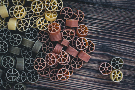 Colorful wheel pasta on a wooden