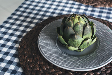 Artichoke on grey plate