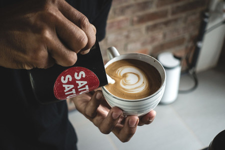 Barista making a perfect latte