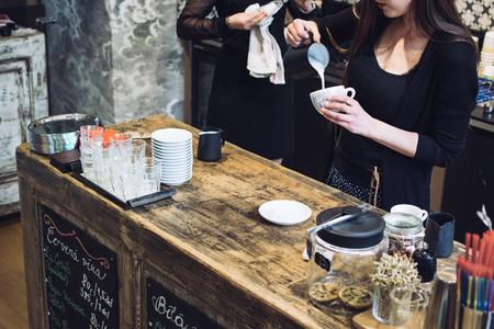 Barista preparing cappuccino