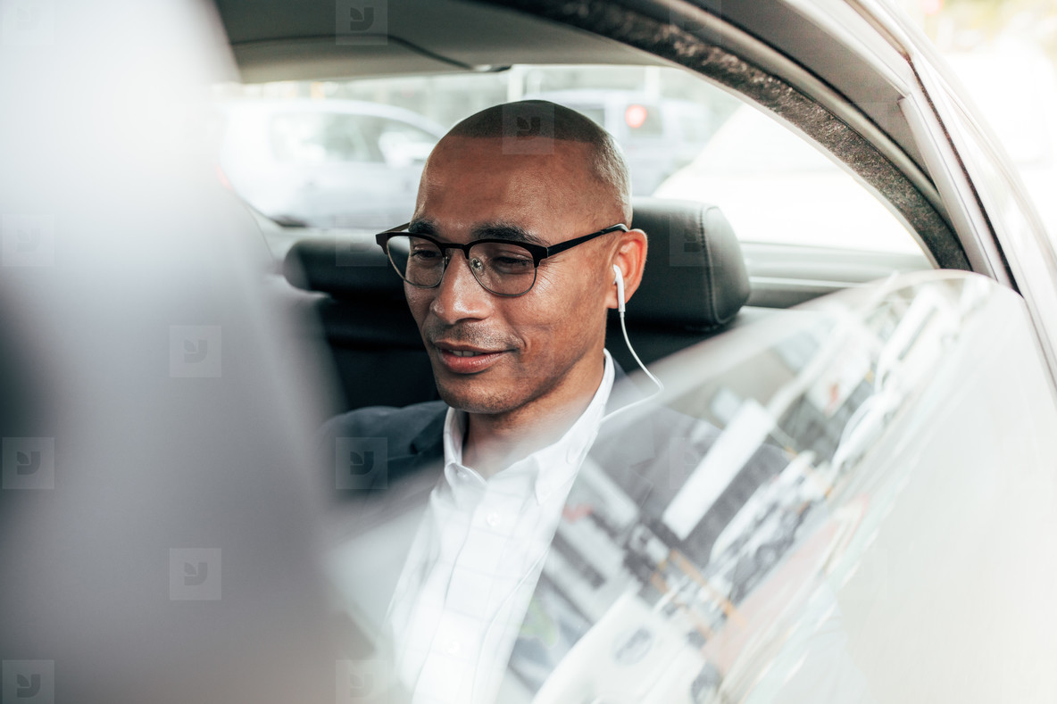 Businessman commuting to office in car