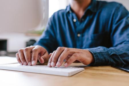 Businessman hands typing on keyboard