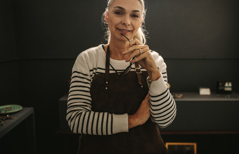Experienced female jeweler in her workshop