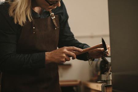 Jeweler designing a silver ring at workstation