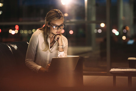Business woman working late on laptop