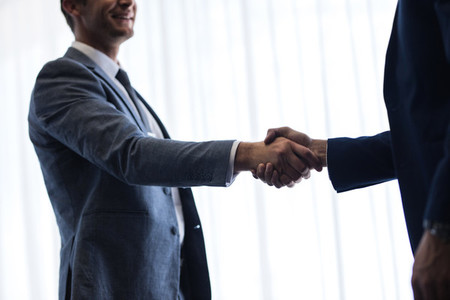 Business men shaking hands with each other