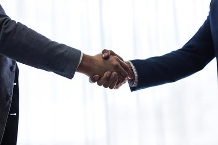 Successful business associates shaking hands