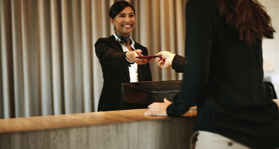 Concierge returning the documents to hotel guest