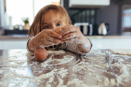 Little girl learning cooking in the kitchen