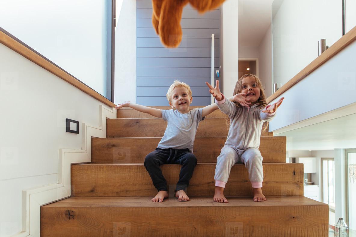 Kids prepared to catch a toy